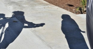 The shadow of an inmate (R) as he is interviewed outside the chapel of the city prison in Ciudad Juarez, Mexico, on February 3, 2016. Pope Francis will visit Ciudad Juarez's prison to meet with inmates during the last stage of his tour along four Mexican states from February 12 to 17.   AFP PHOTO/ Yuri CORTEZ / AFP / YURI CORTEZ        (Photo credit should read YURI CORTEZ/AFP/Getty Images)